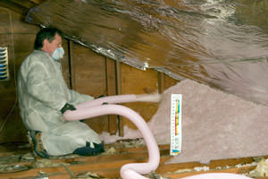 Fiberglass Insulation being used to add energy efficiency to an attic in Palm Coast