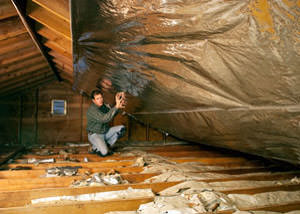 A radiant barrier installed in a Lake City attic